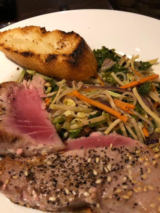 Pho Bowl -- seared ahi over rice noodles and veggie blend with green curry broth at Ode to Food and Drinks.