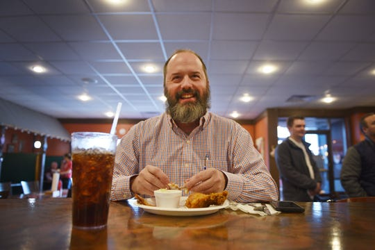 Regular customer Troy Kogel eats fried chicken and coleslaw at The Keg Chicken during lunch time Tuesday, Dec. 4, at the restaurant in Sioux Falls.