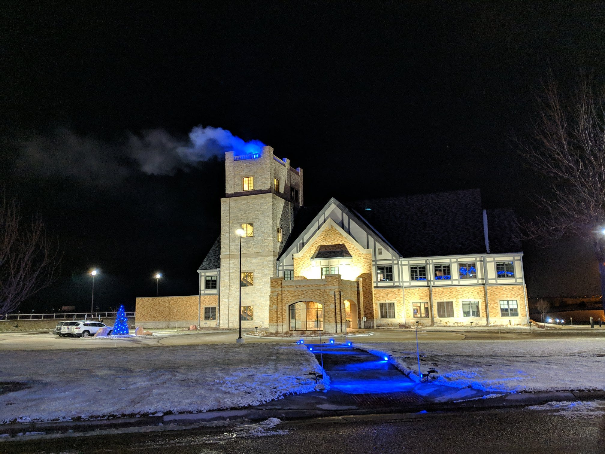 Blue smoke wafted above the Sanford Health headquarters in Sioux Falls Tuesday, Dec. 4 as a way to announce that a recipient of the Lorraine Cross Award was chosen.