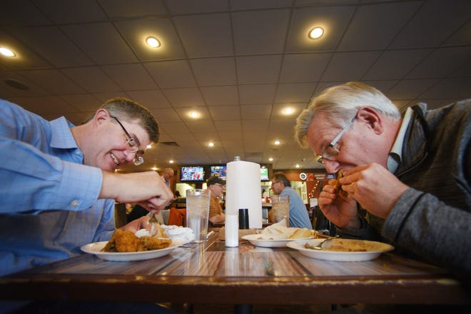 Del Peters, left, and Dan Graber, right, eat at The Keg Chicken during lunch time Tuesday, Dec. 4, at the restaurant in Sioux Falls.