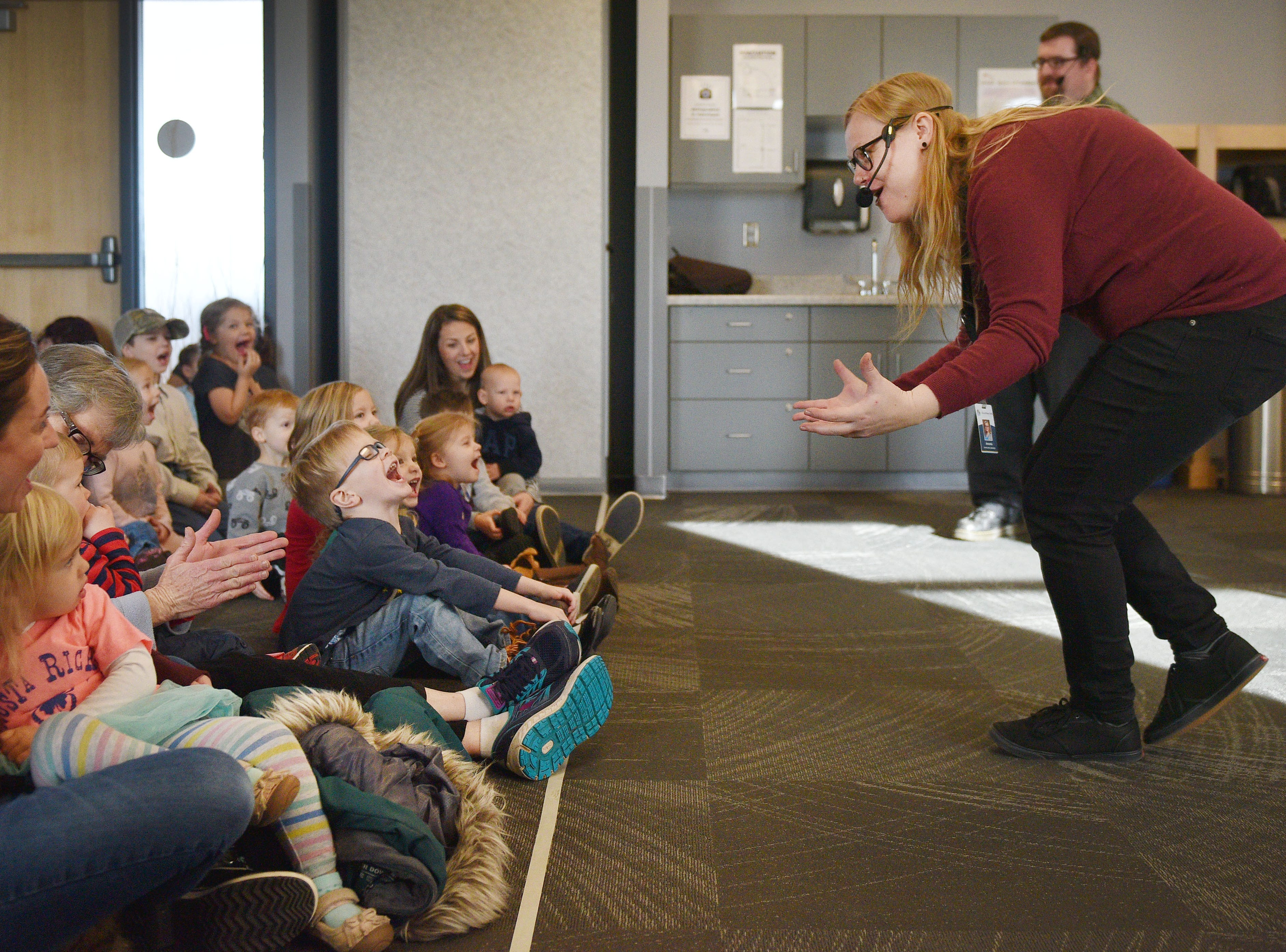 Library Associate Amanda Bremmon asks the kids if they are ready for The Christmas Gift puppet show at the Prairie West Branch Wednesday, Dec. 5, in Sioux Falls.