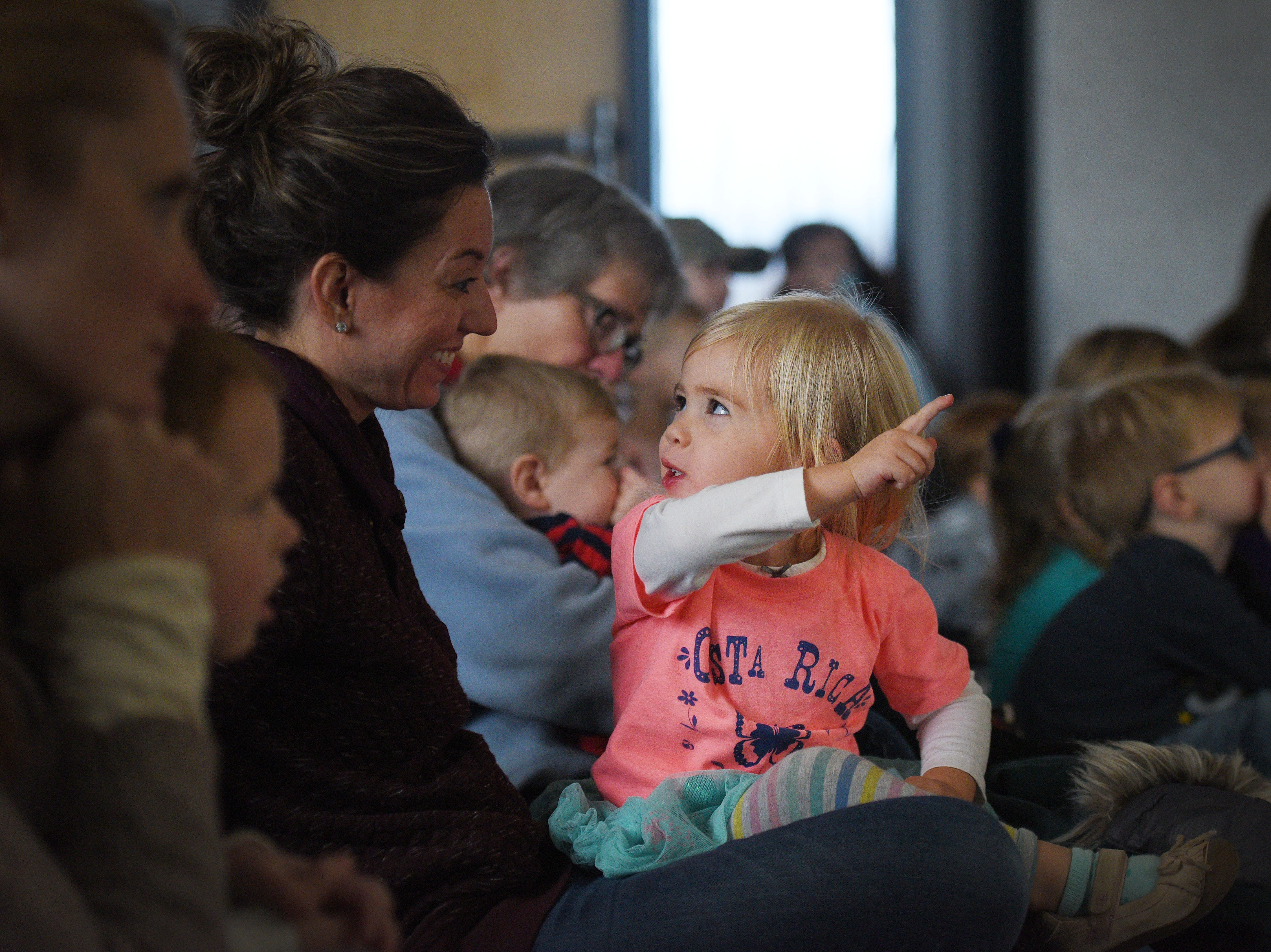 Amelia Neilson talks to her mom Melissa during The Christmas Gift puppet show at the Prairie West Branch Wednesday, Dec. 5, in Sioux Falls.