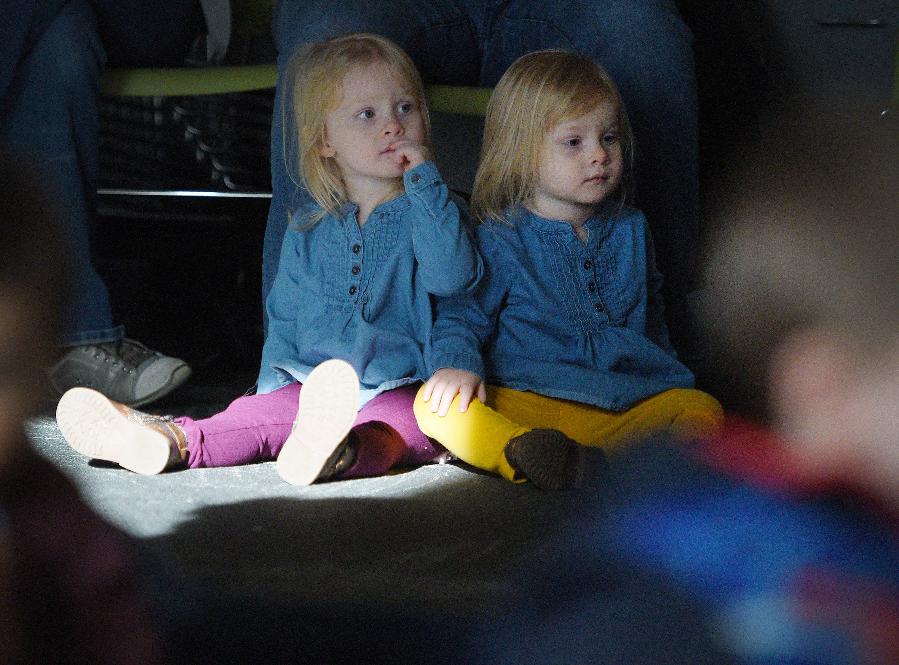 Anastasia and Reagan Houtsma watch The Christmas Gift puppet show at the Prairie West Branch Wednesday, Dec. 5, in Sioux Falls.
