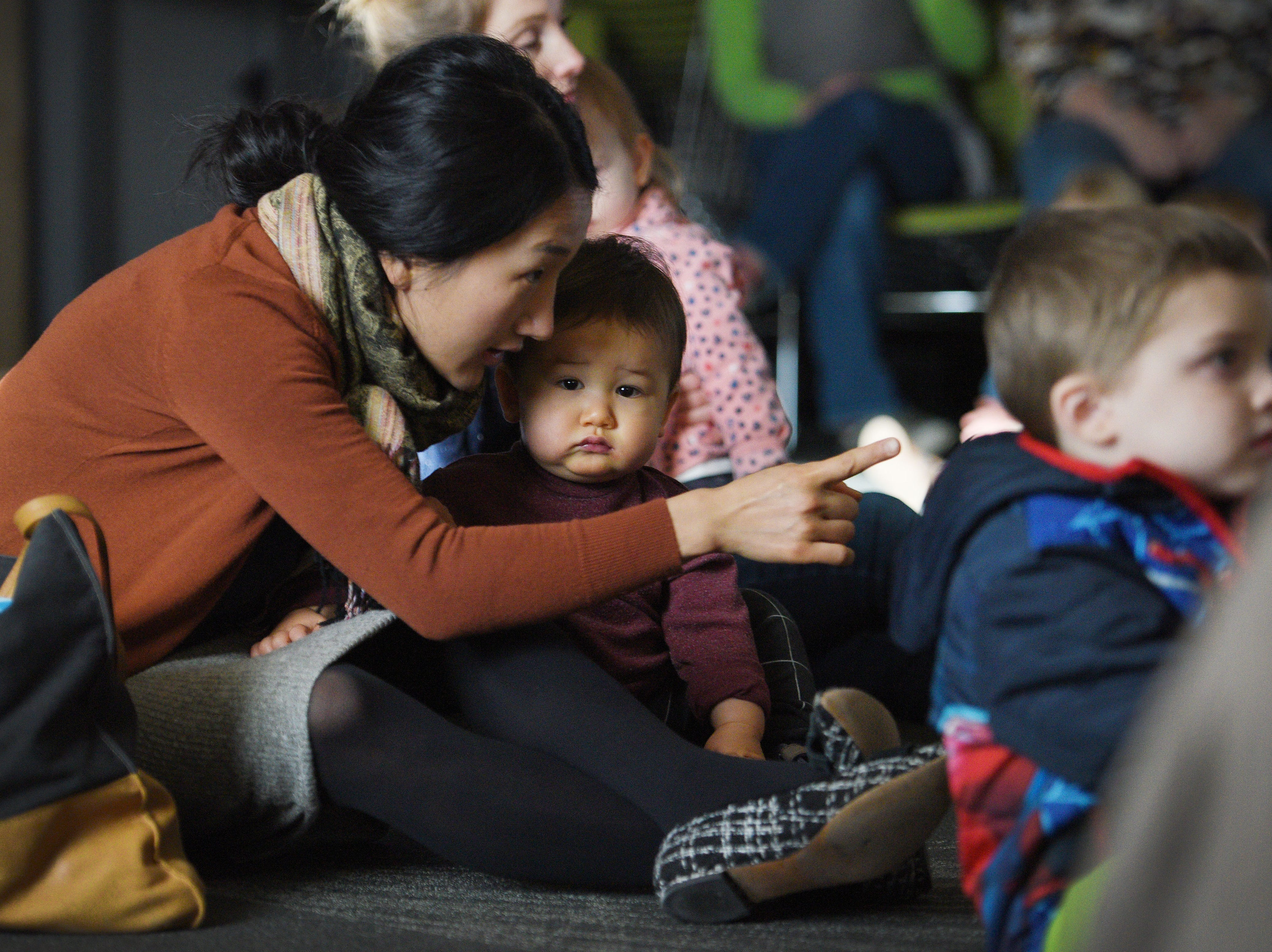 Dohui Kim watches The Christmas Gift puppet show with her son Henry Emerson at the Prairie West Branch Wednesday, Dec. 5, in Sioux Falls.