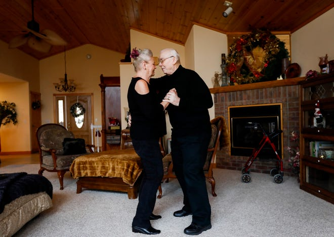 Alberta and her husband, Ernie Cooper, dance in their living room on Tuesday, Dec. 5, 2018. Alberta is caring for Ernie, who has Alzheimer's.