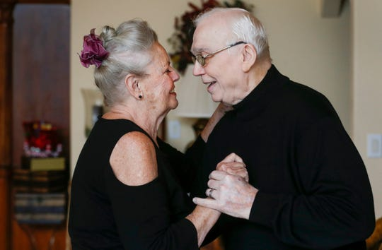 Alberta and her husband, Ernie Cooper, dance in their living room on Dec. 5. Alberta is caring for Ernie, who has Alzheimer's.