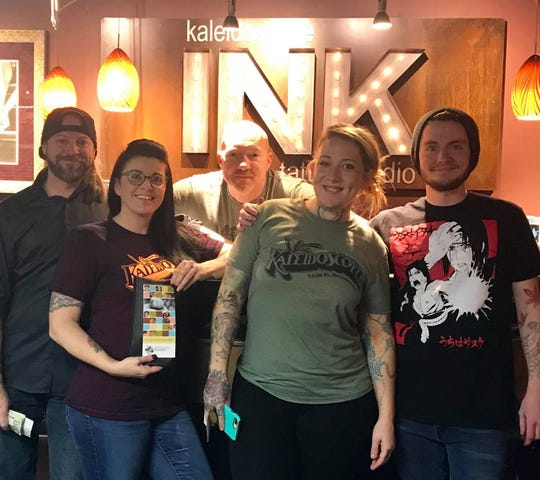 The staff at Kaleidoscope Ink gave 100 percent of Tuesday's proceeds to help foster kids in the Ozarks. Pictured (from left) are artist Ryan McCurter, shop manager Bobbie Marsh, artist Zack Hook, artist Amanda Herren, and apprentice Collin Joiner.