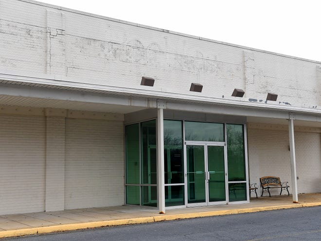 The outline of the long removed signage for the Peebles store that was once over an exterior entrance to the closed store at the Staunton Mall.