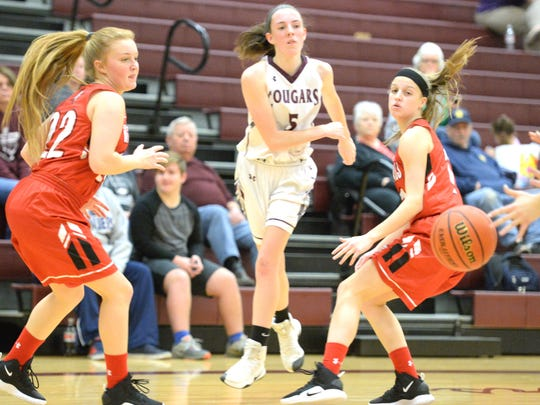 Stuarts Draft's Lyndsay Harris fires a pass between a pair of Riverheads' defenders Tuesday in a Shenandoah District basketball game.