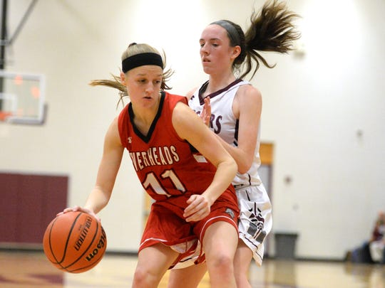 Riverheads' Sara Moore is guarded by Stuarts Draft's Lyndsay Harris Tuesday during a Shenandoah District basketball game.