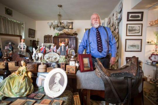 Frank Earnest with his collection of Confederate items at his home in Virginia Beach.