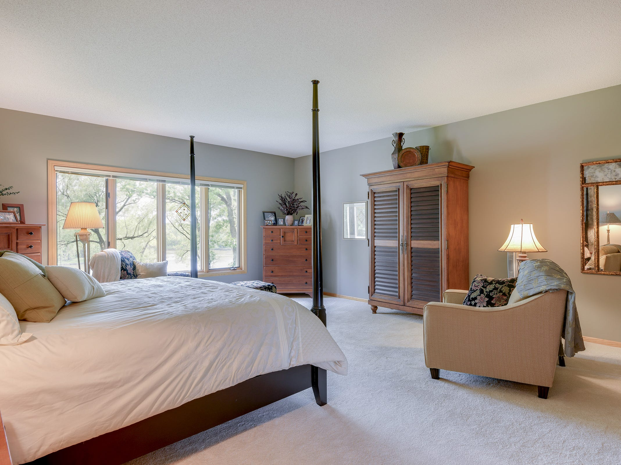 The master bedroom sits on the main floor and has waterfront views.