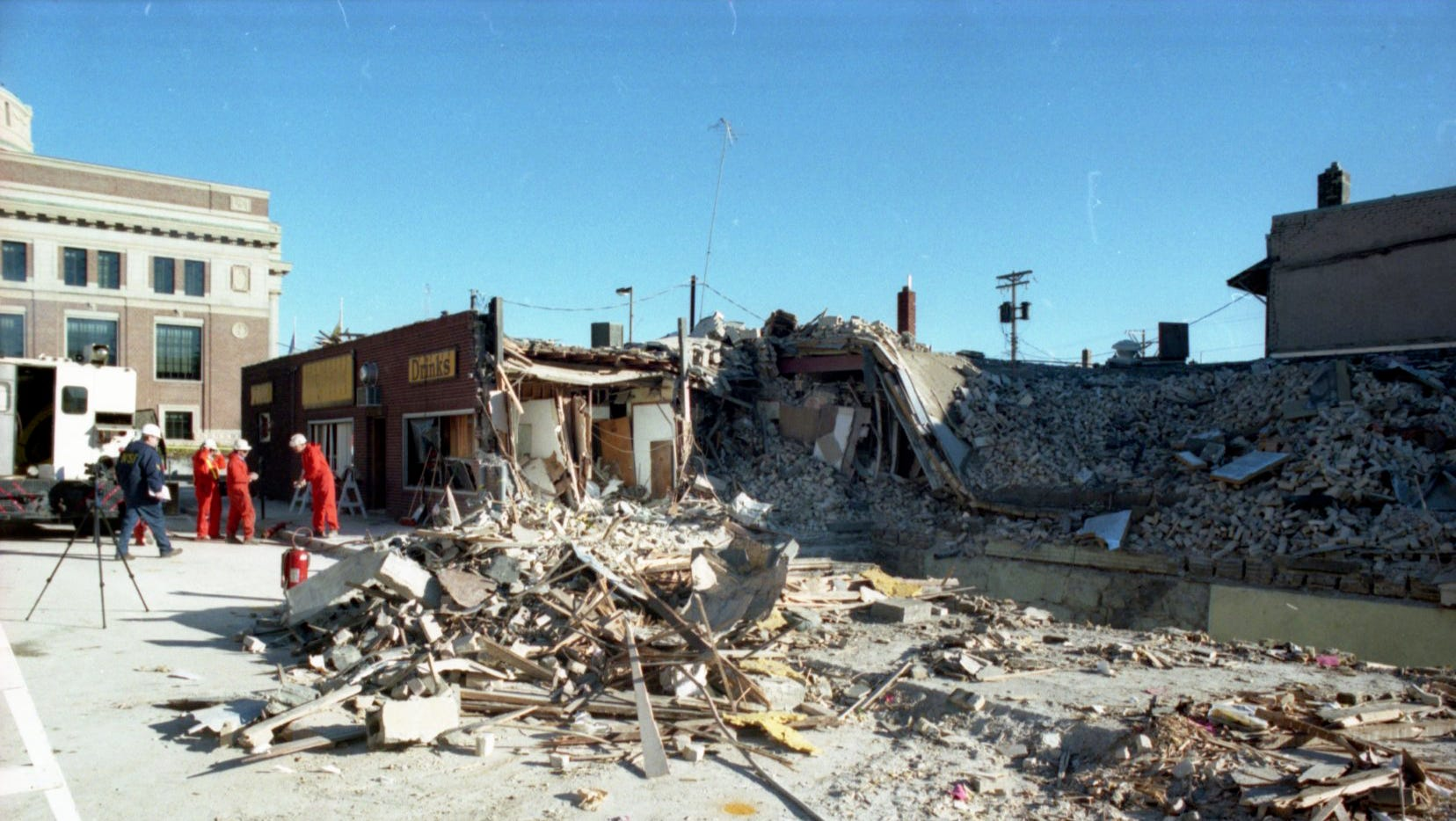 With some rubble cleared away, investigators worked Dec. 12, 1998 to find what caused Friday's explosion.