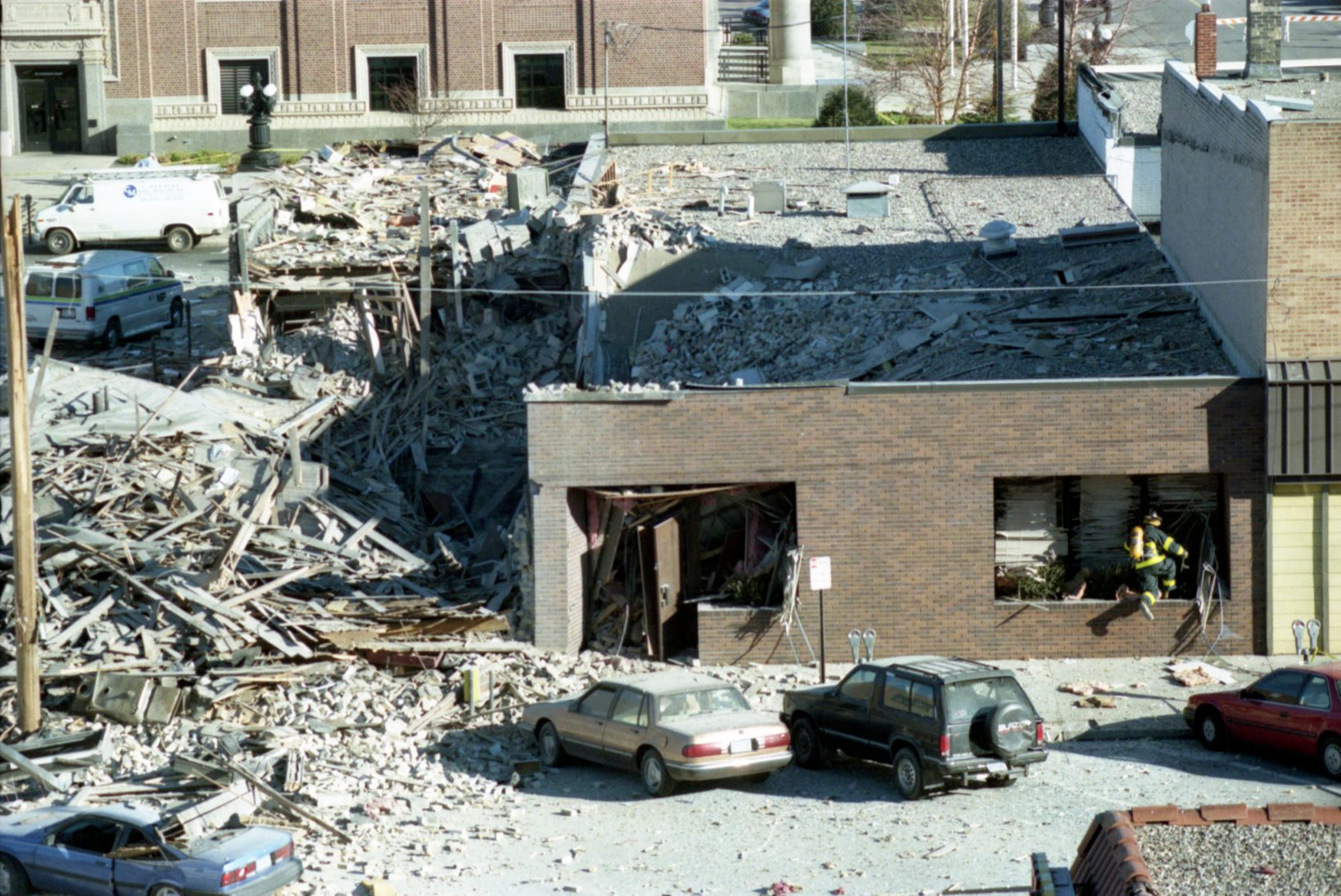 Rubble from a gas explosion litters Ninth Avenue on Dec. 12, 1998, one day after Bellantti's Pizza & Deli exploded.