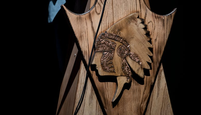 """An Iron County School Board panel takes public comments during a special hearing about the name of Cedar High School's mascot, """"Redmen"""" in CHS Tuesday, December 4, 2018. A member of the Paiute tribe pointed out at the meeting that the warband headdress of the lectern wasn't representative of the Paiute people, and an example of misrepresentation by the school."""