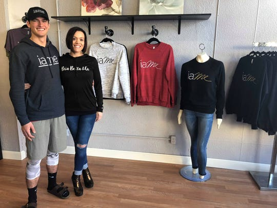 Alec Mancheski, CEO and founder of iame clothing stands with Tara Manzke, owner of Bria Bella & Co. at the store.