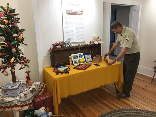 Dan Fisk sets up a wooden train set at the lighthouse.