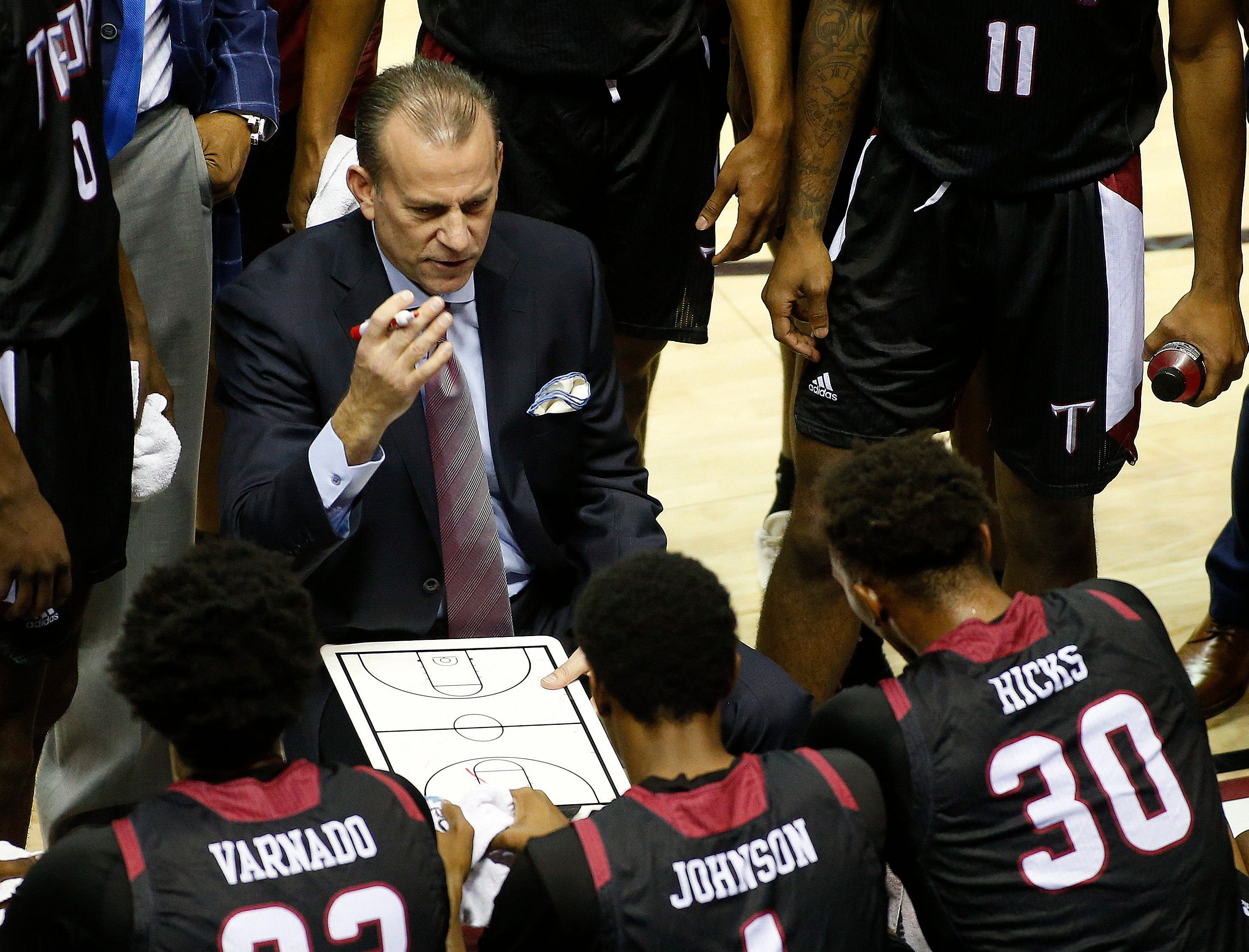 Dec 3, 2018; Tallahassee, FL, USA;  Troy Trojans head coach Phil Cunningham draws up a play while playing against the Florida State Seminoles at Donald L. Tucker Center during the first half. Mandatory Credit: Glenn Beil-USA TODAY Sports