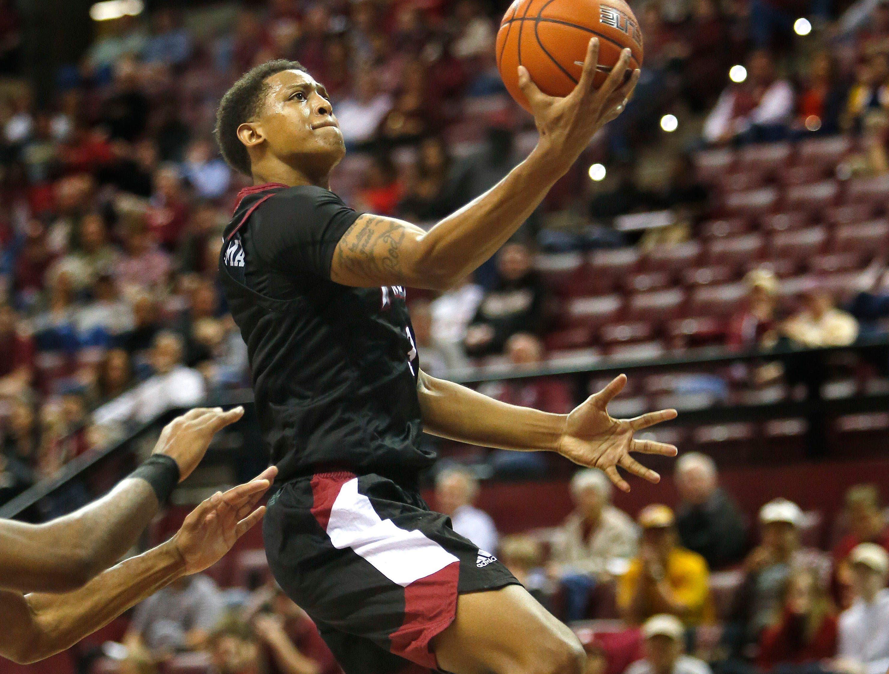 Dec 3, 2018; Tallahassee, FL, USA; Troy Trojans guard Darian Adams (3) scores against the Florida State Seminoles at Donald L. Tucker Center during the second half. Mandatory Credit: Glenn Beil-USA TODAY Sports