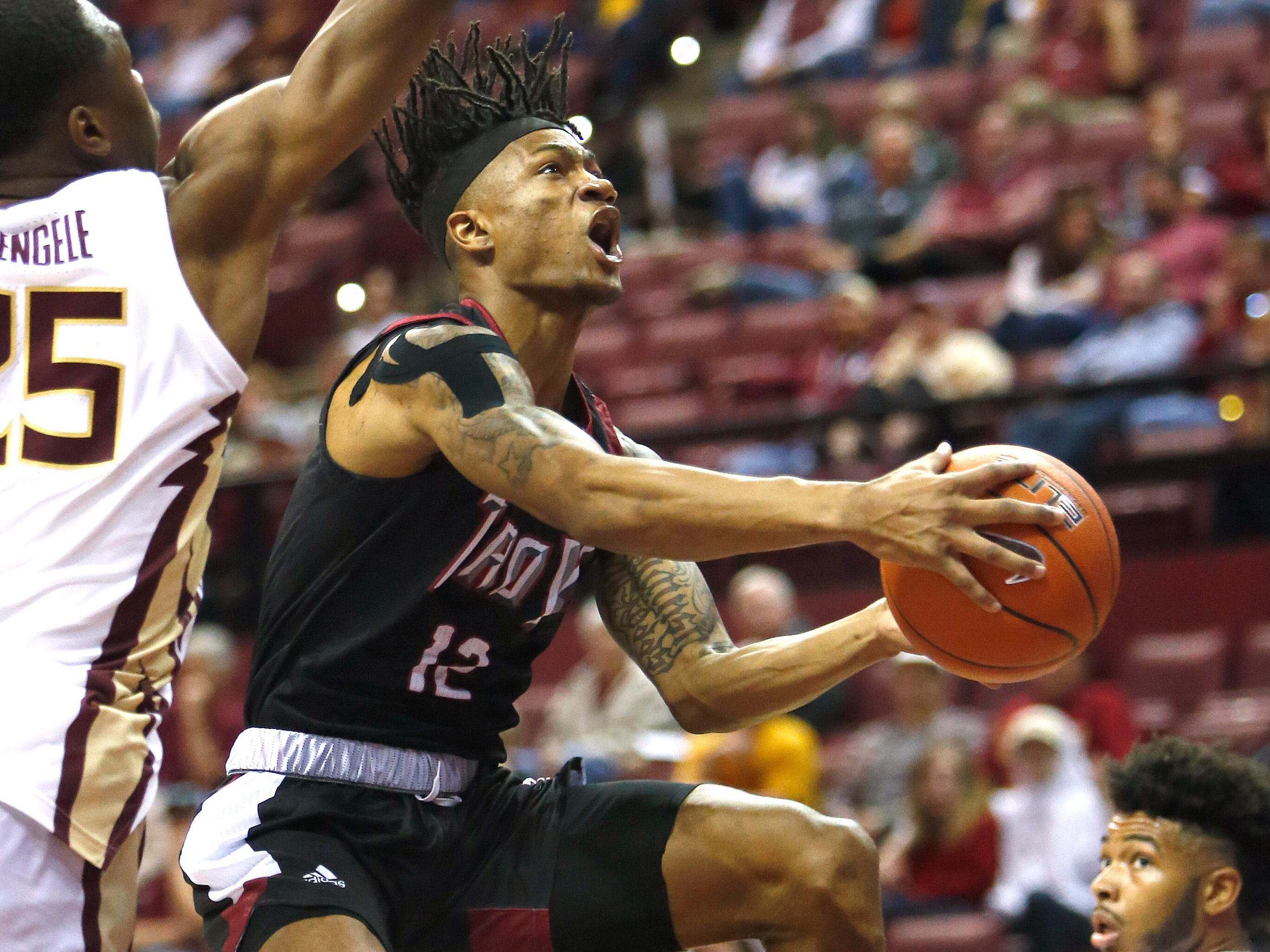 Dec 3, 2018; Tallahassee, FL, USA; Troy Trojans guard Charles Norman (12) drives to the hoop against the Florida State Seminoles at Donald L. Tucker Center during the second half. Mandatory Credit: Glenn Beil-USA TODAY Sports