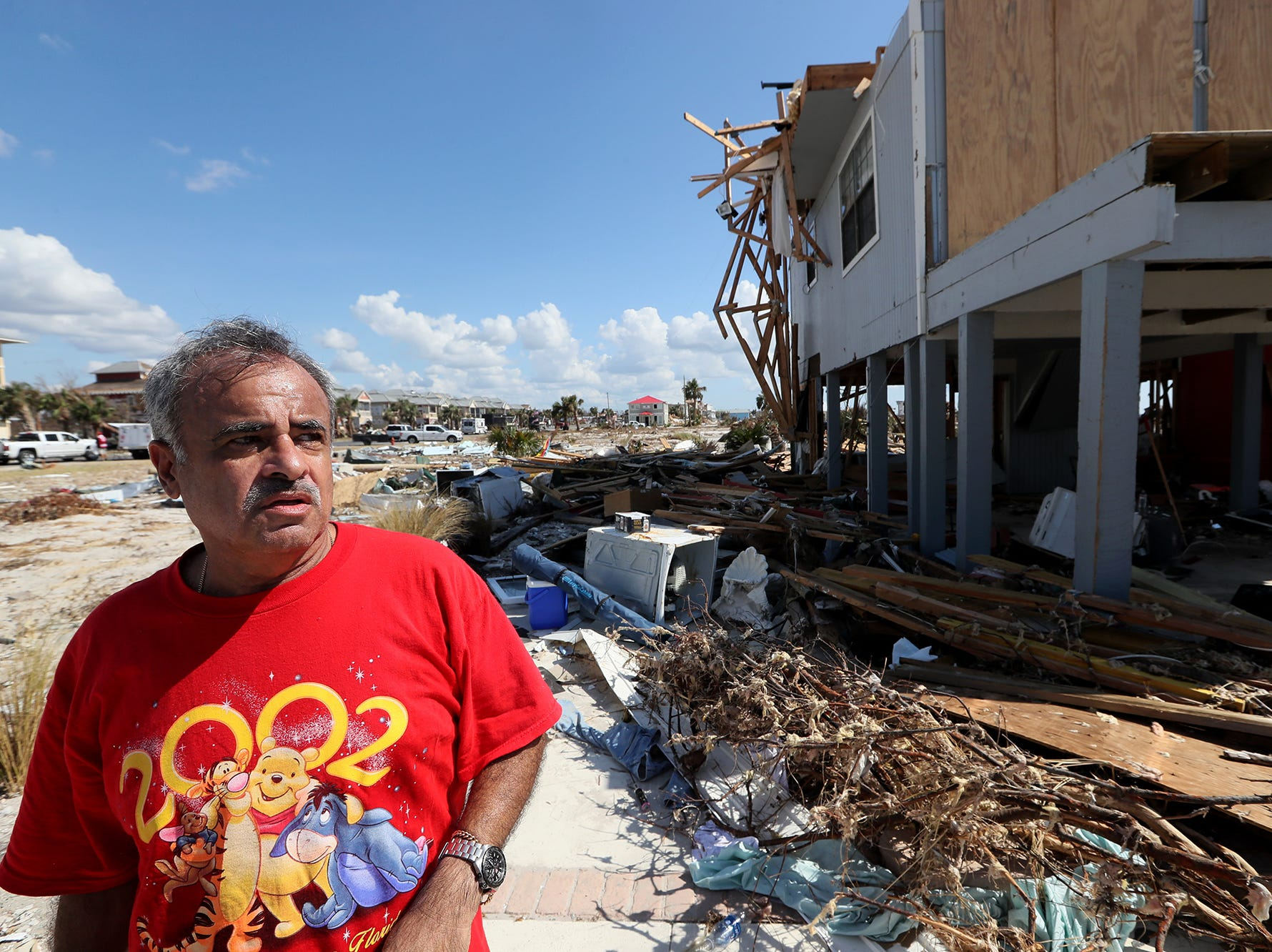 Jaques Sebastiao stands outside of his demolished Mexico Beach home on Wednesday, Oct. 17, 2018, one week after Hurricane Michael ripped through the coastal Florida town. Sebastiao moved in to the home fulltime with his with wife Bela in August, just two months before the storm hit.