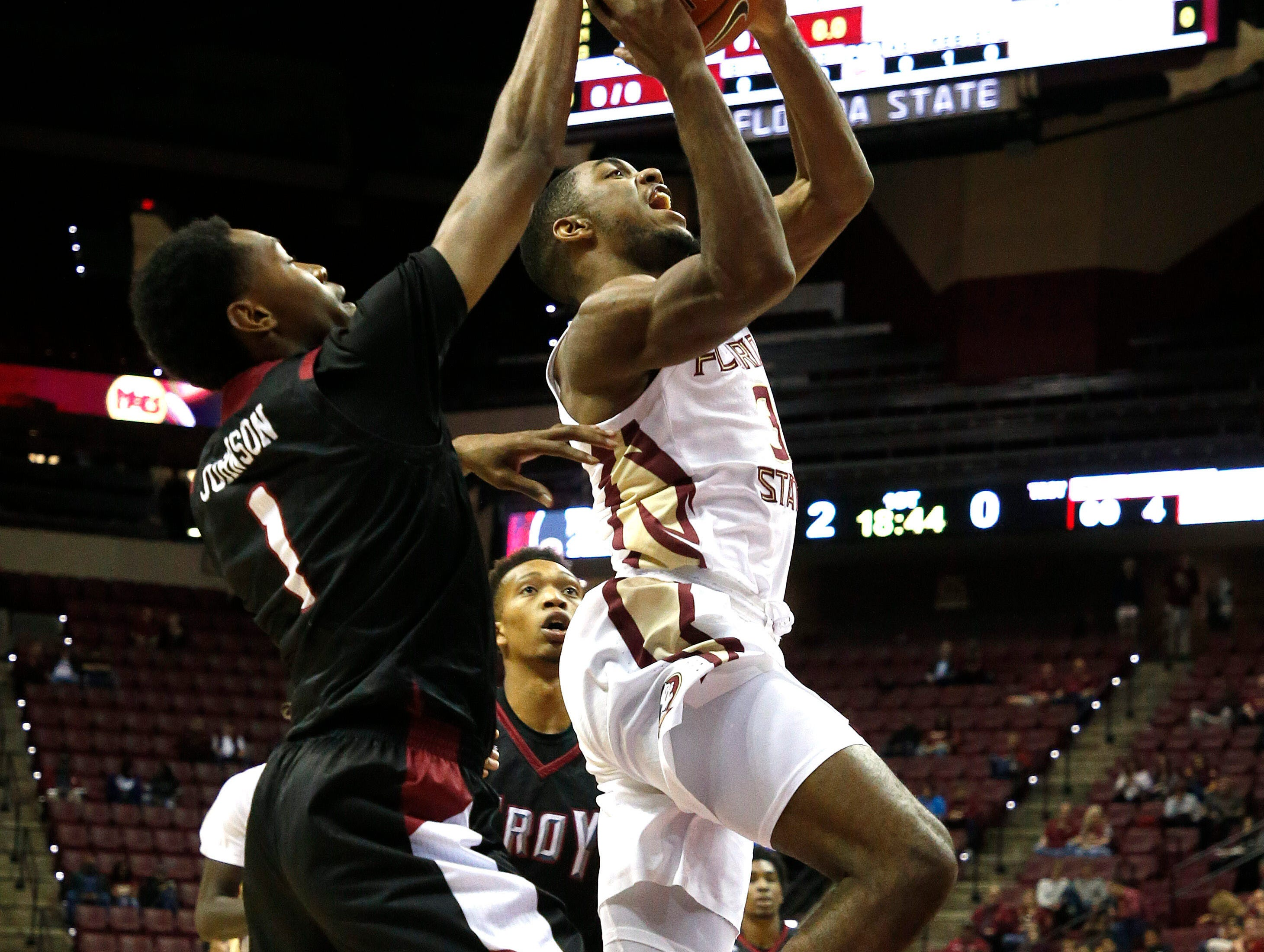 Dec 3, 2018; Tallahassee, FL, USA;  Troy Trojans forward Javan Johnson (1) is called for a foul against Florida State Seminoles guard Trent Forrest (3) at Donald L. Tucker Center during the first half. Mandatory Credit: Glenn Beil-USA TODAY Sports