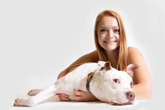 Makenzi Swanson, with her dog Debow.