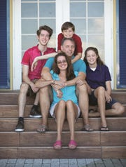 After receiving a cancer diagnosis, Gil Smart was reminded of what was most important to him—family. Smart is pictured here surrounded by those who are most precious to him. Clockwise from the top: his son Aiden; daughter Annabelle; wife, Kimberly; and son Alex.