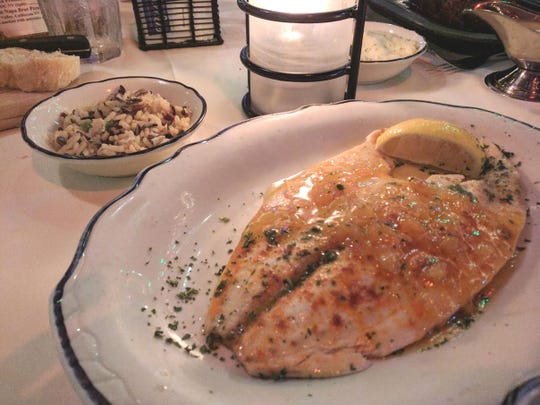 Ocean Grill's pompano with apricot sauce and Southern pecan rice pilaf.