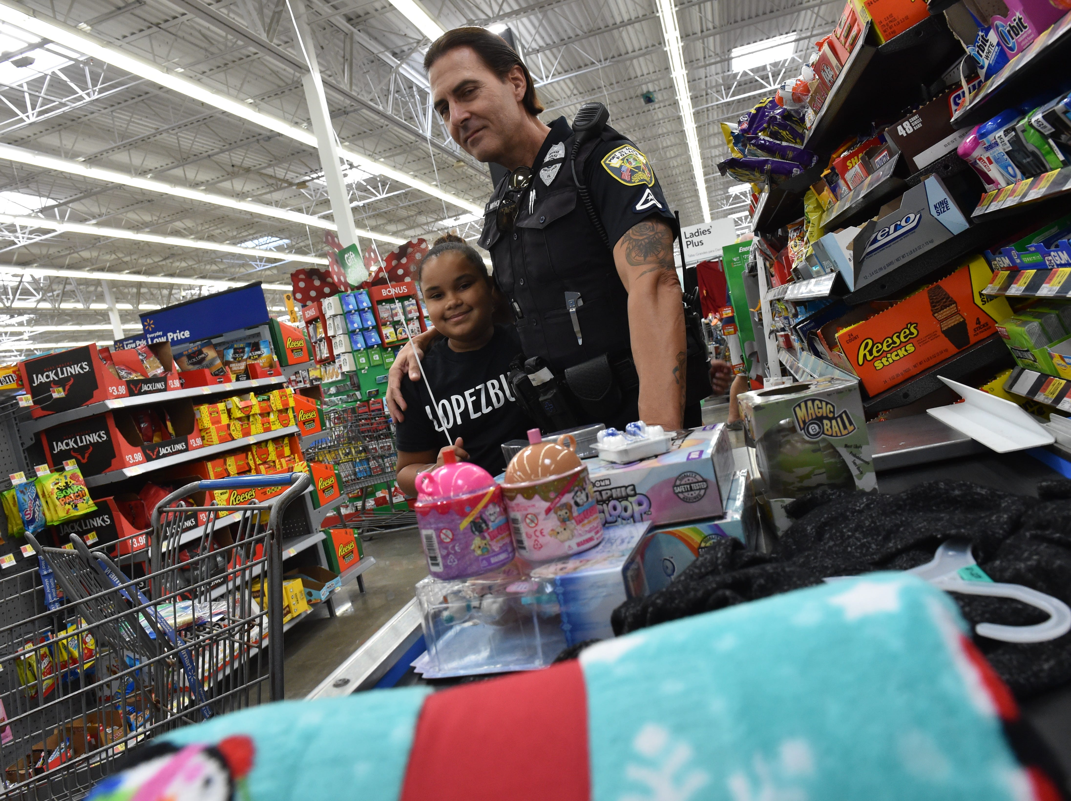 Port St. Lucie Police Department's 13th Annual Shop with a Cop event at the Walmart Supercenter at 10855 S. US Highway 1 in Port St. Lucie. Thirty three children from Port St. Lucie were treated to the Christmas shopping event, getting help from police officers and a $3,500 grant from Walmart and donations from private citizens, allowing the children to shop for Christmas gifts.