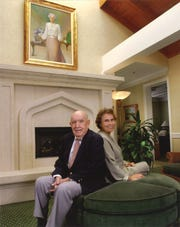 Leo W. Pierce, left, and Kathie Pierce sitting in front of Peggy Pierce's portrait inside the VNA Hospice House in Vero Beach.