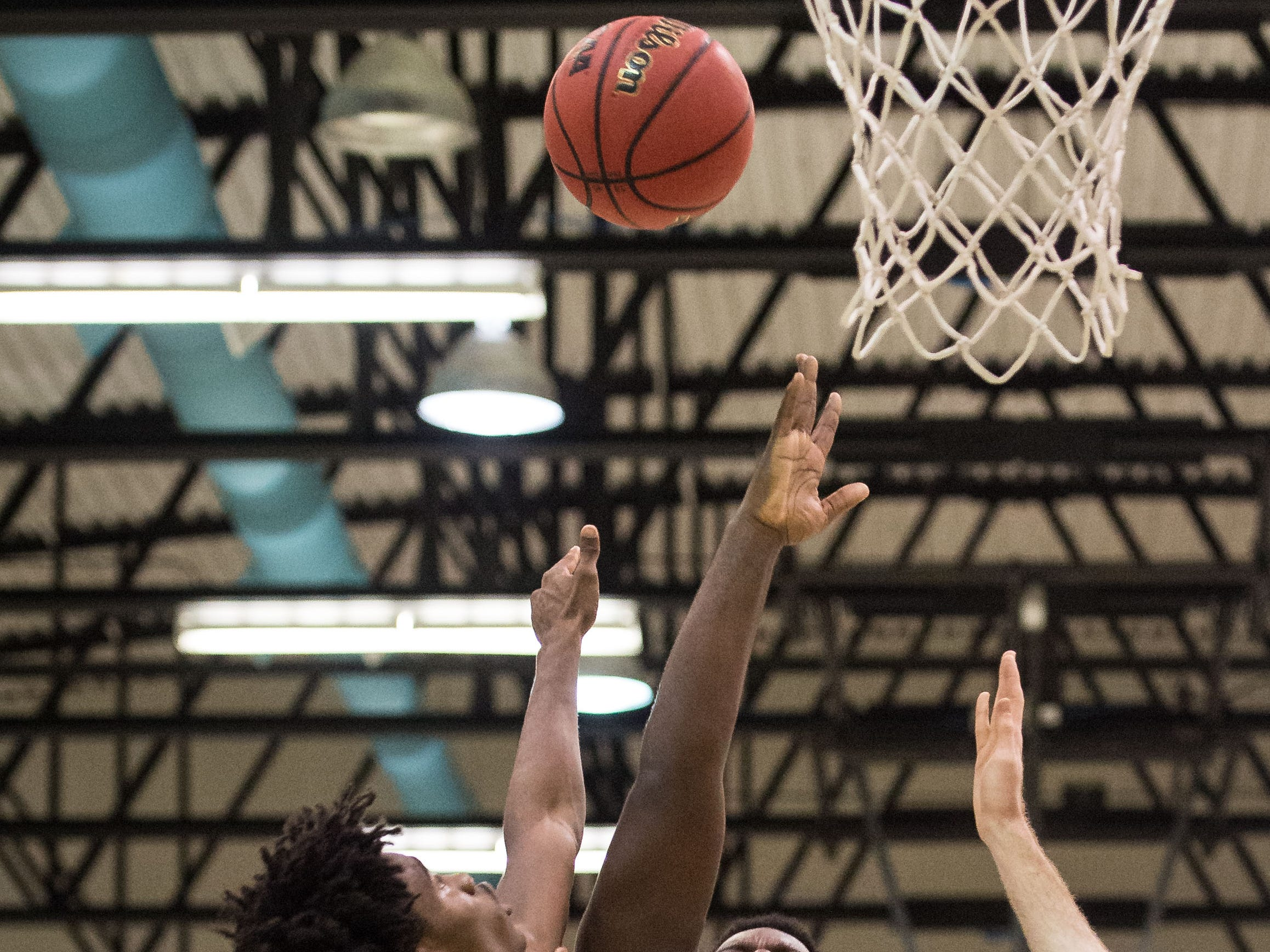 Jensen Beach's Emanuel Rogers goes up for the shot and is fouled by Treasure Coast's Nemuel Robinson during the fourth period of the high school boys basketball game Tuesday, Dec. 4, 2018, at Jensen Beach High School.