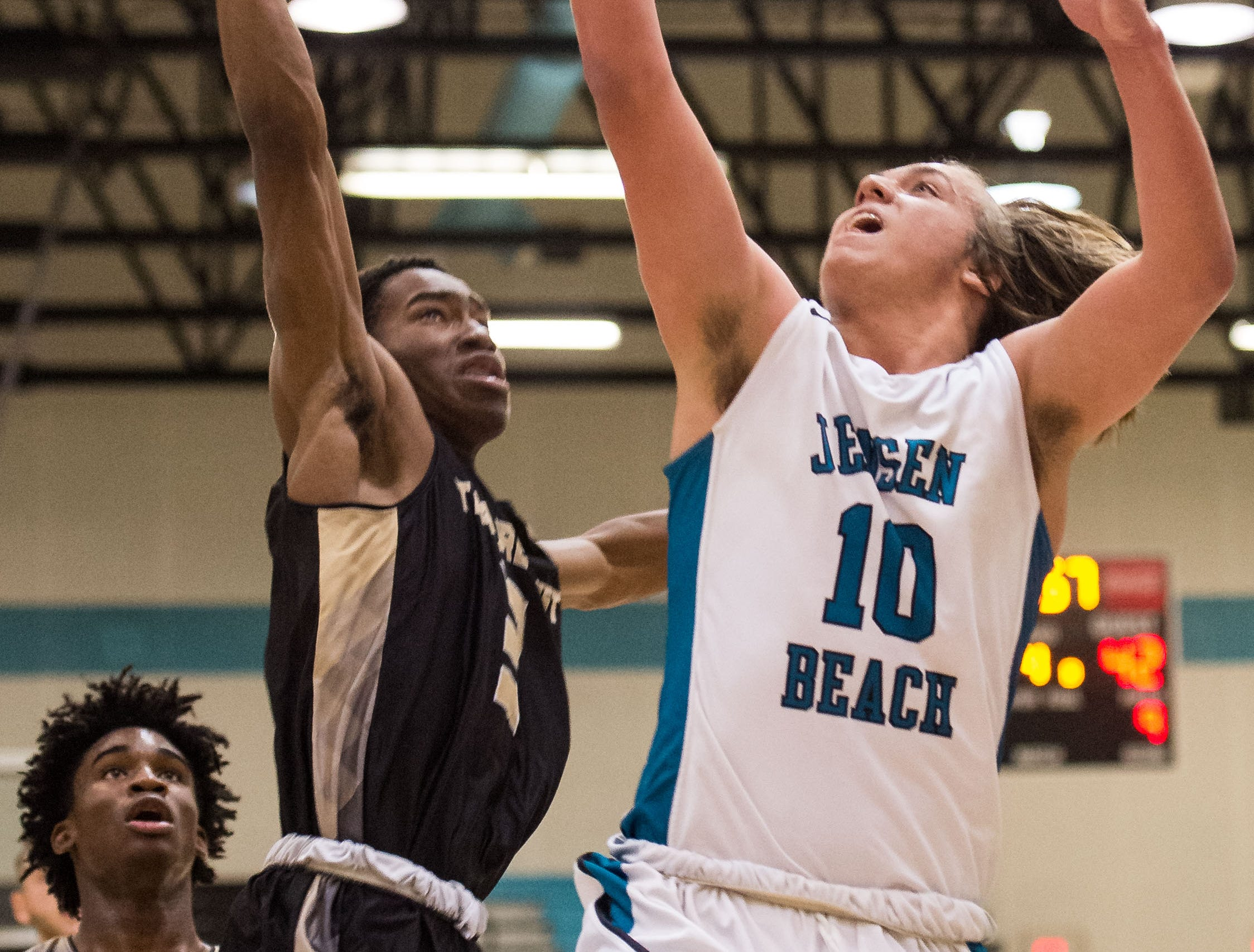 Jensen Beach plays against Treasure Coast during the high school boys basketball game Tuesday, Dec. 4, 2018, at Jensen Beach High School.
