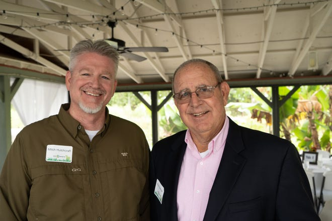 Mitch Hutchcraft and Rick Hartman discuss agriculture and business at the 2018 Martin County Farm City Luncheon at Kai-Kai Farms in Indiantown.