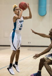 Jensen Beach's Jay Laboy attempts a three-pointer against Treasure Coast during the second period of the high school boys basketball game Tuesday, Dec. 4, 2018, at Jensen Beach High School.