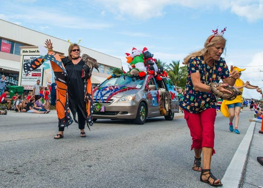 Floats and decorated vehicles created by chamber members, schools and charity organizations drifted merrily along the roadway.