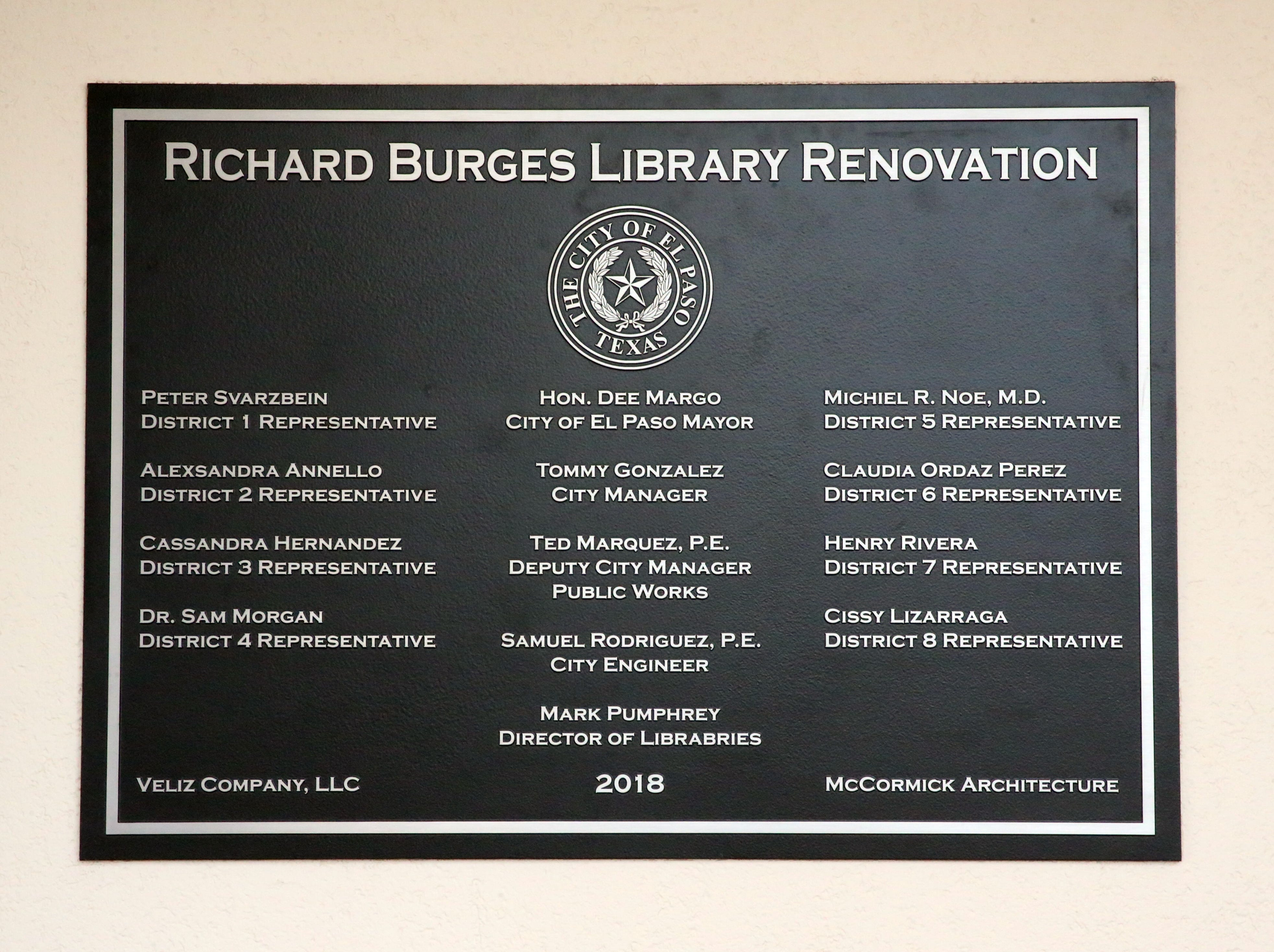 A new plaque is placed next to the old one outside the Richard Burges Library.