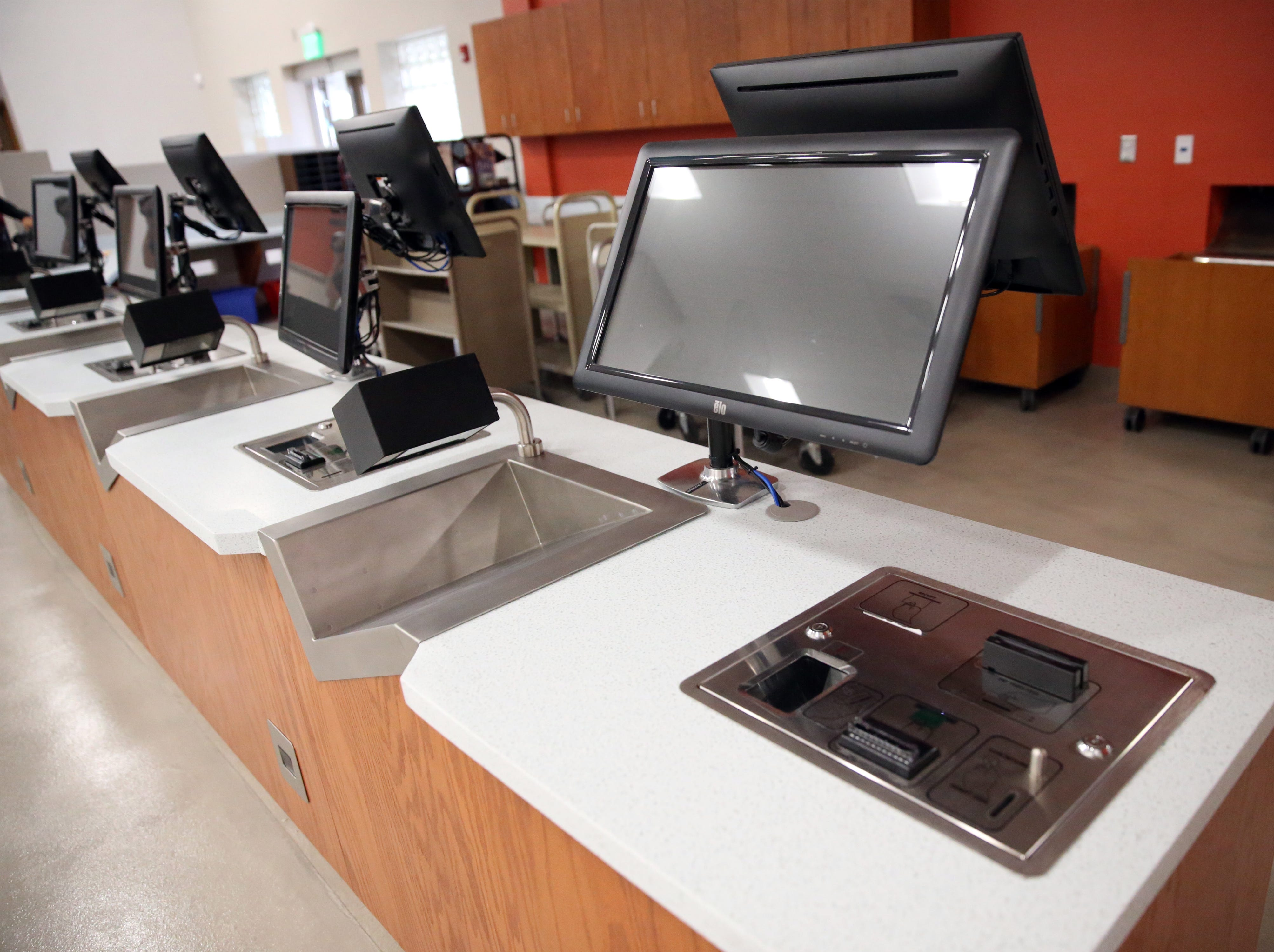 Self serve book checkout stations are among the improvements to the Richard Burges Library.