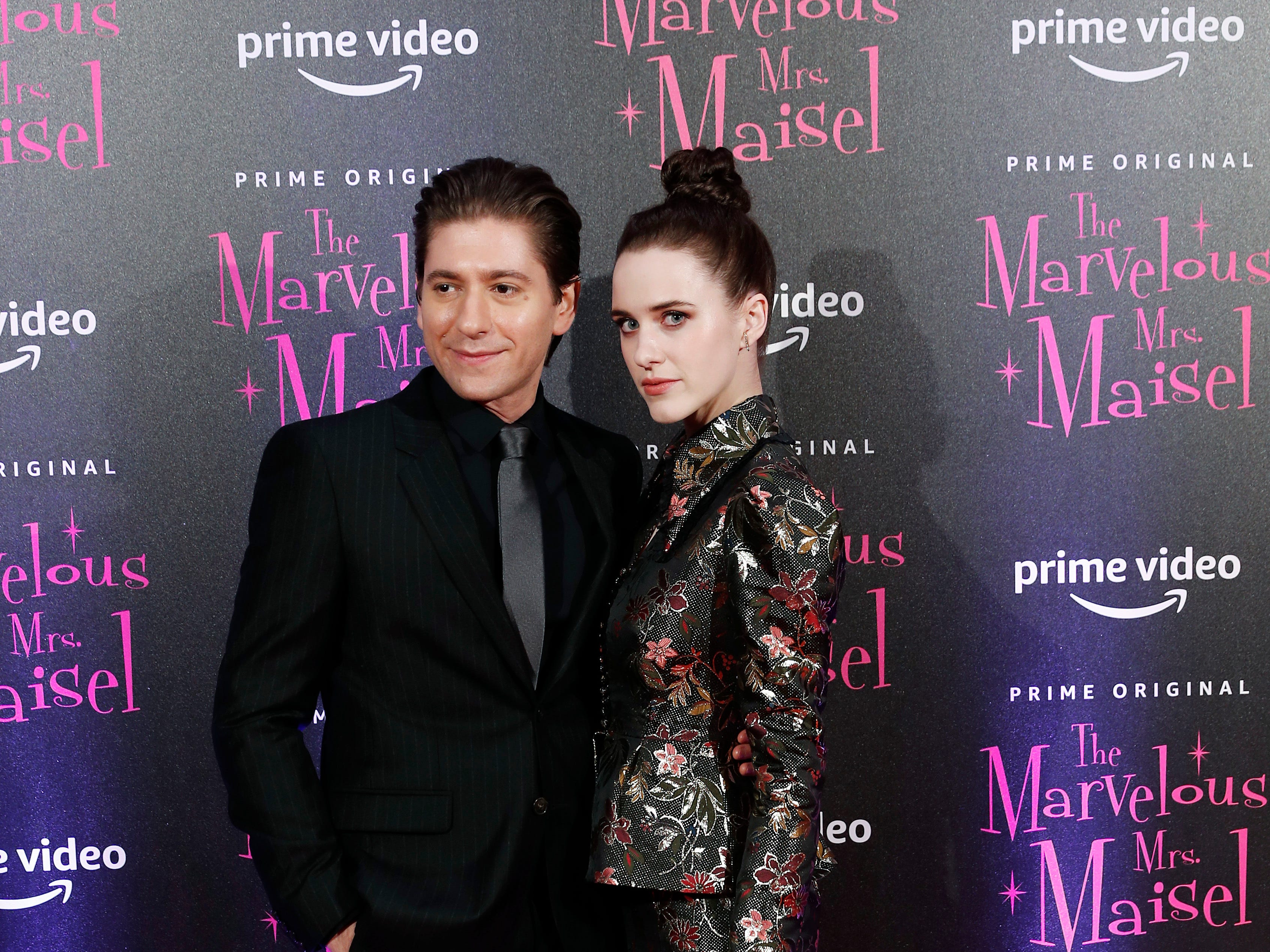 """Actress Rachel Brosnahan, right, and actor Michael Zegen pose for photographers at the European Premiere of """"The Marvelous Mrs. Maisel"""" season 2, in Milan, Italy, Monday, Dec. 3, 2018."""