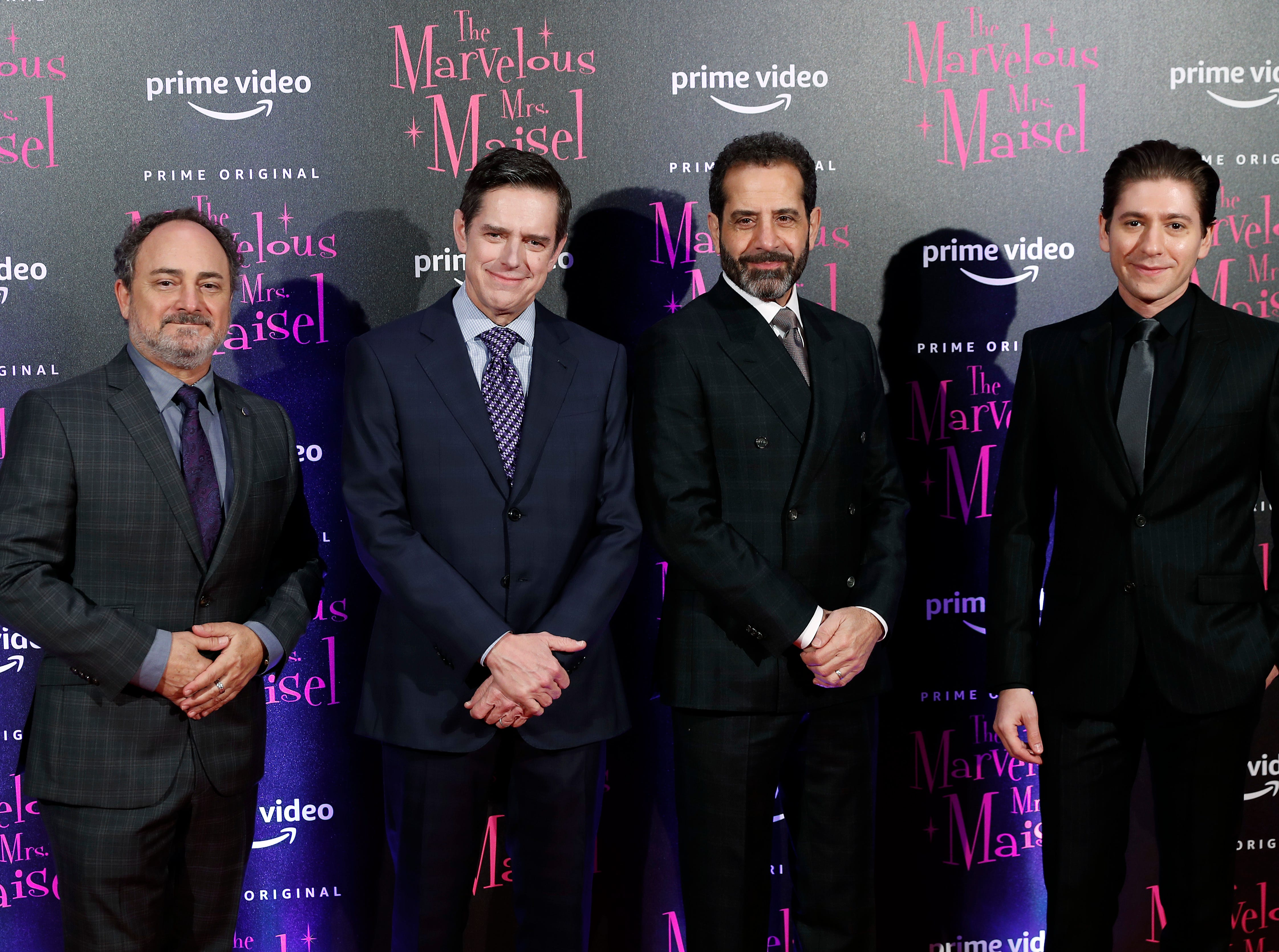 """From left: Kevin Pollack, Dan Palladino, Tony Shalhoub and Michael Zegen pose for photographers with Marin Hinkle, right, and actor Tony Shalhoub at the European Premiere of """"The Marvelous Mrs. Maisel"""" season 2, in Milan, Italy, Monday, Dec. 3, 2018."""