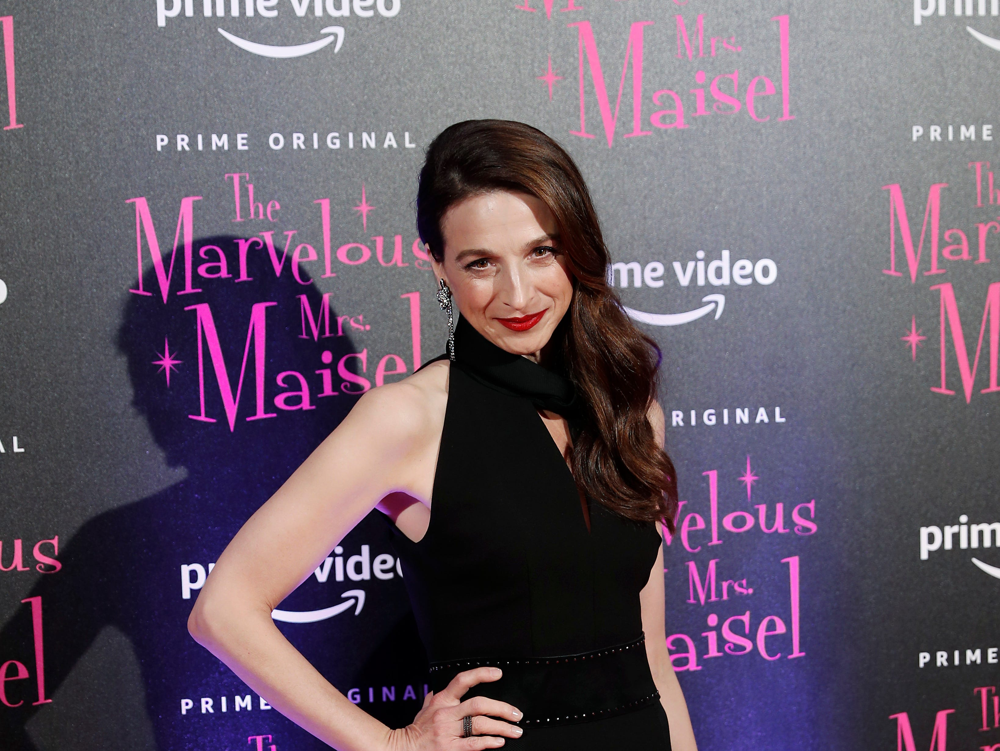 """Actress Marin Hinkle poses for photographers at the European Premiere of """"The Marvelous Mrs. Maisel"""" season 2, in Milan, Italy, Monday, Dec. 3, 2018. (AP Photo/Antonio Calanni)"""