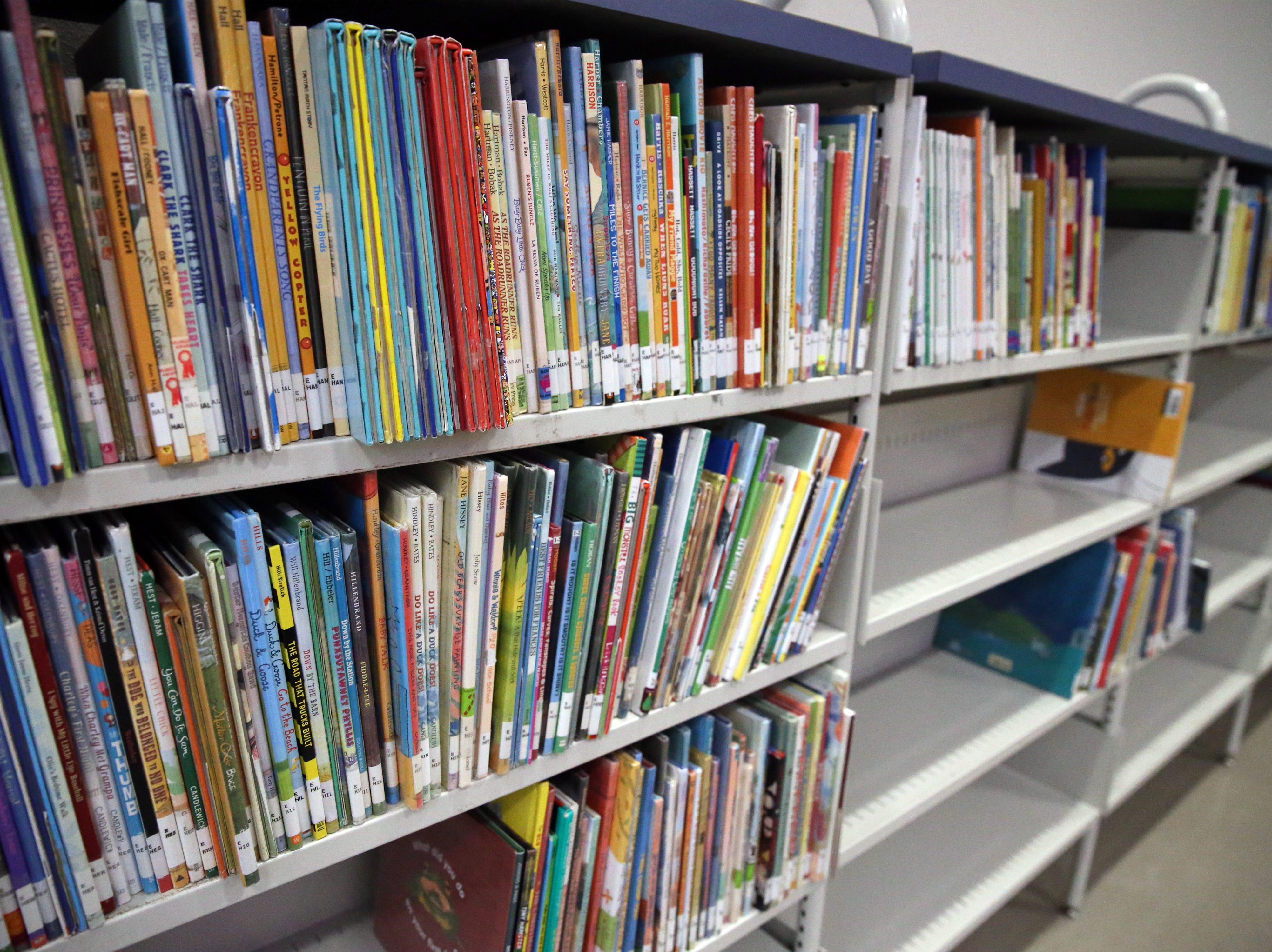 Books are getting shelved inside the Kids Zone of the Richard Burges Library Wednesday.