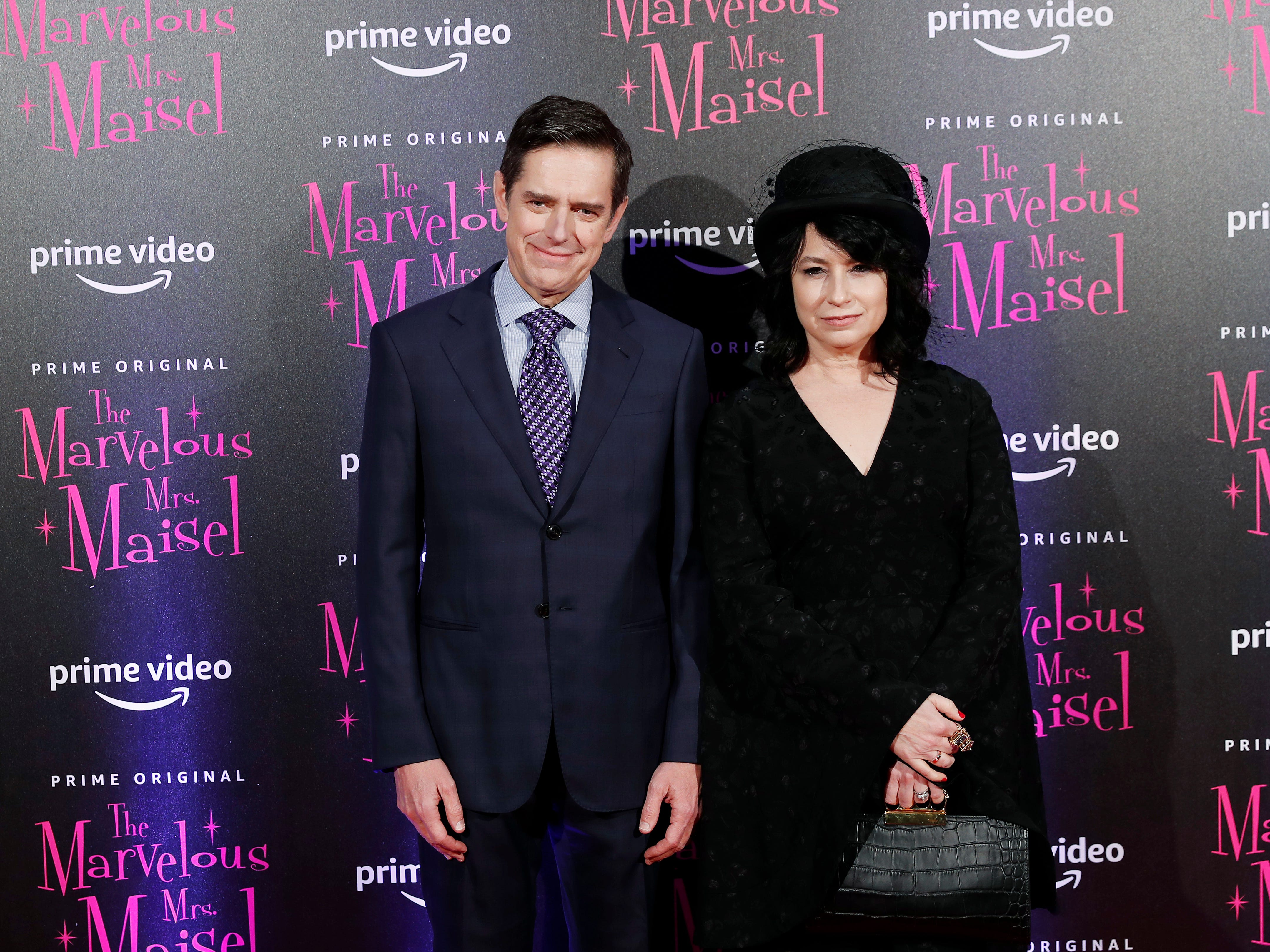 """Amy Sherman Palladino, left, and Dan Palladino pose for photographers at the European Premiere of """"The Marvelous Mrs. Maisel"""" season 2, in Milan, Italy, Monday, Dec. 3, 2018."""