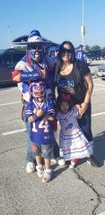 Ezra Castro poses with his family outside NRG Stadium in Houston before a game between the Buffalo Bills and the Houston Texans.