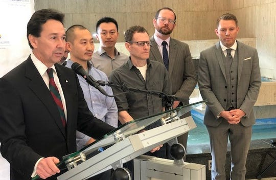 Jon Barela, Borderplex Alliance CEO, talks about Curacubby, a Berkeley, Calif., high-tech startup that is opening an office in Downtown El Paso at a news conference Wednesday, Dec. 5, 2018. Steven Khuong, Curacubby CEO, is next to Barela, along with Brian Meckler, in glasses, the company's chief technology officer.
