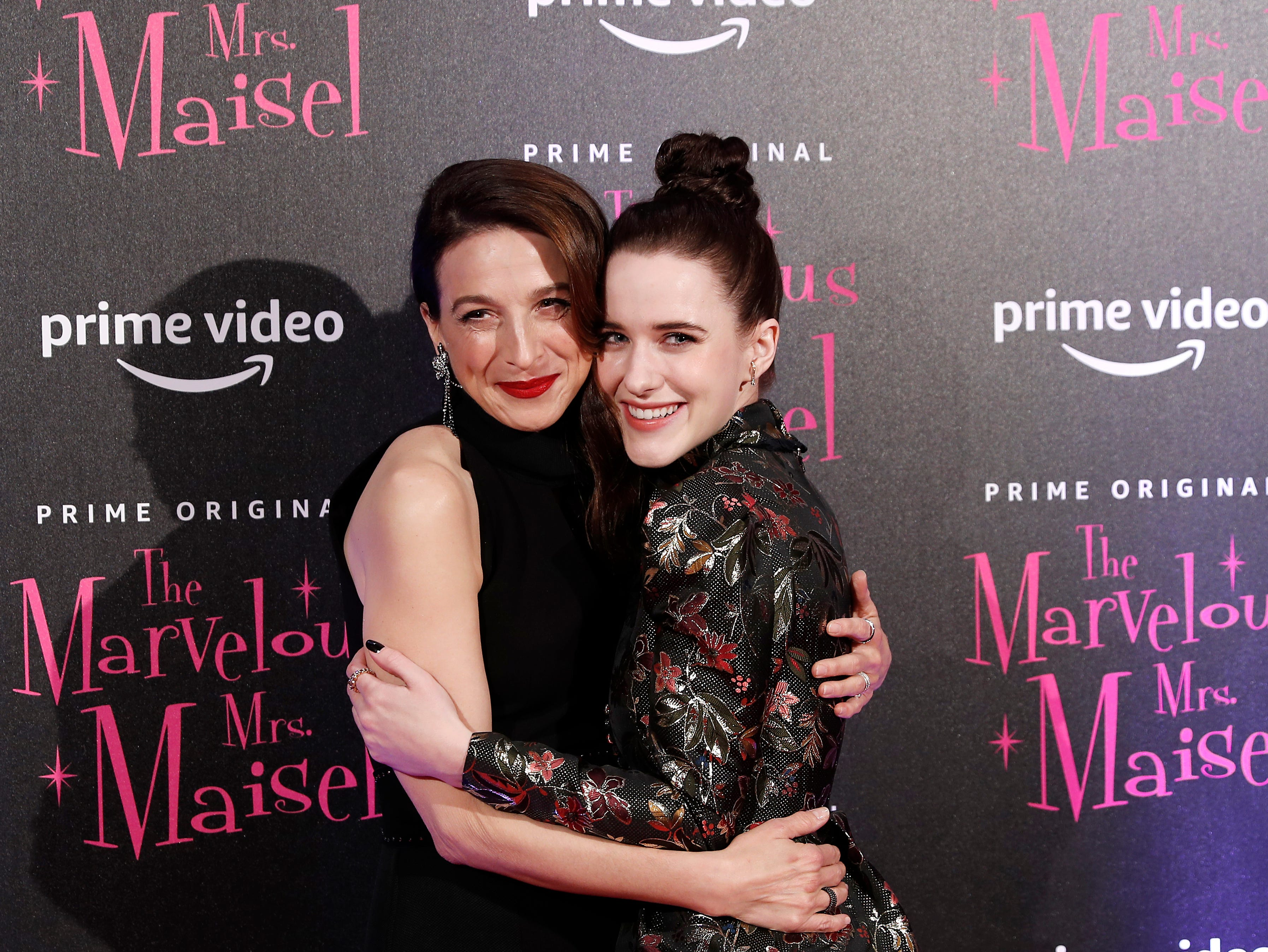 """Actress Rachel Brosnahan, right, and Marin Hinkle pose for photographers at the European Premiere of """"The Marvelous Mrs. Maisel"""" season 2, in Milan, Italy, Monday, Dec. 3, 2018."""