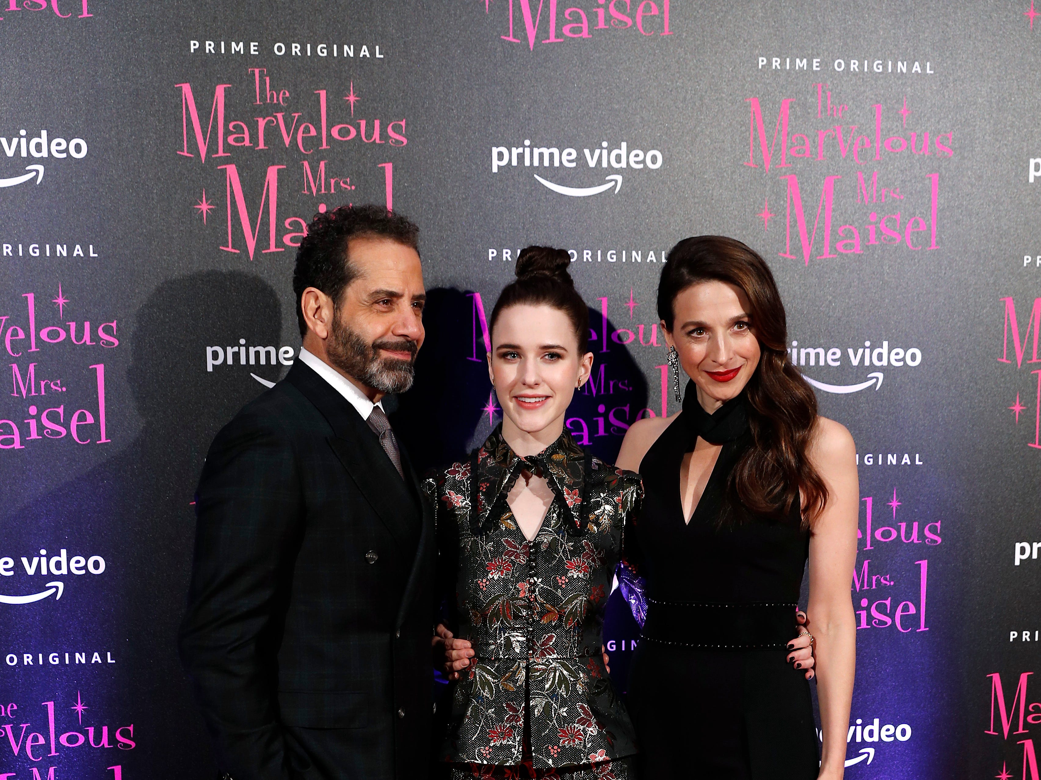"""Actress Rachel Brosnahan, center, poses for photographers with Marin Hinkle, right, and actor Tony Shalhoub at the European Premiere of """"The Marvelous Mrs. Maisel"""" season 2, in Milan, Italy, Monday, Dec. 3, 2018."""