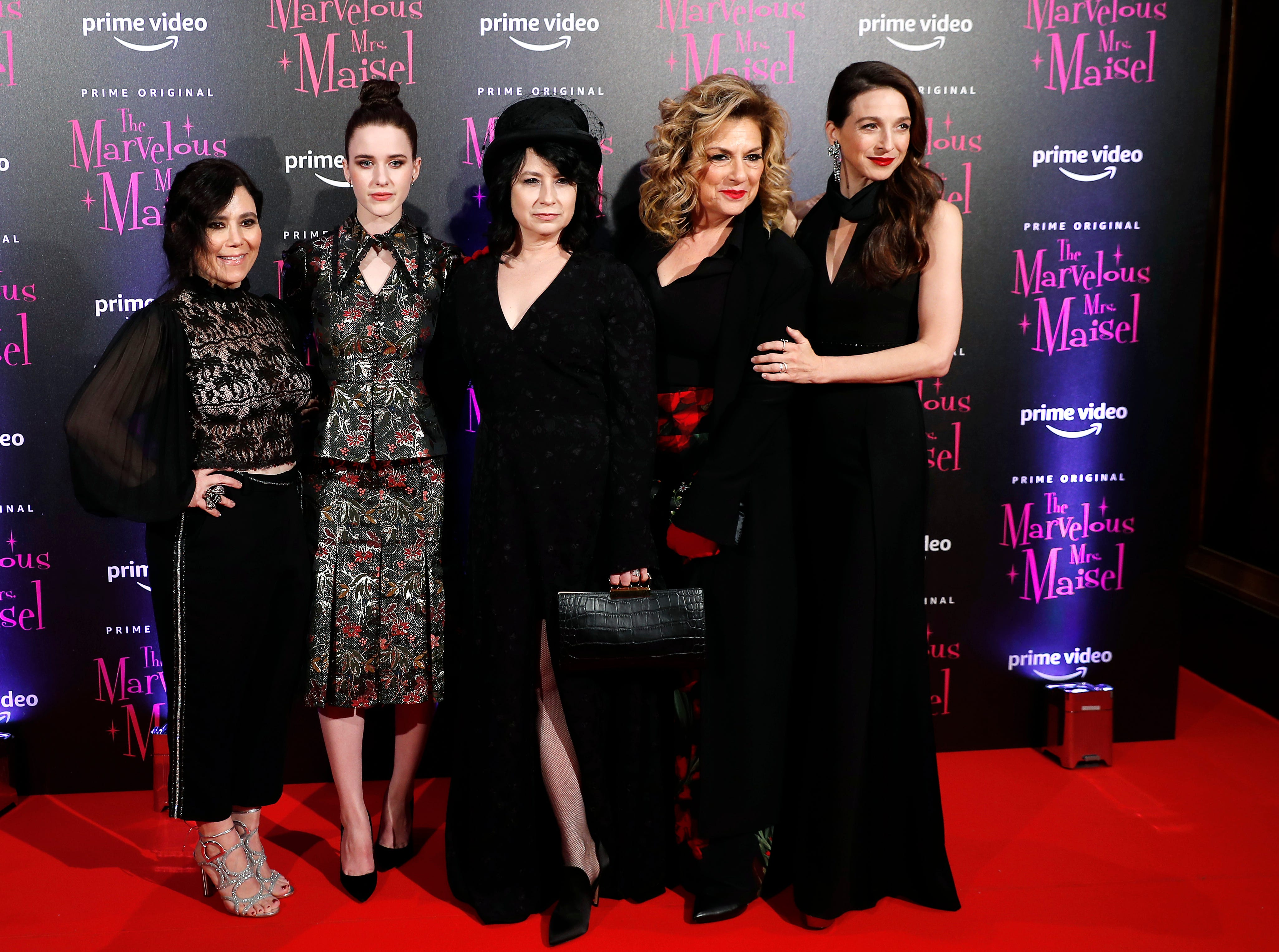 """From left: Alex Borstein, Rachel Brosnahan, Amy Sherman Palladino, Caroline Aaron and Marin Hinkle pose for photographers with Marin Hinkle, right, and actor Tony Shalhoub at the European Premiere of """"The Marvelous Mrs. Maisel"""" season 2, in Milan, Italy, Monday, Dec. 3, 2018."""