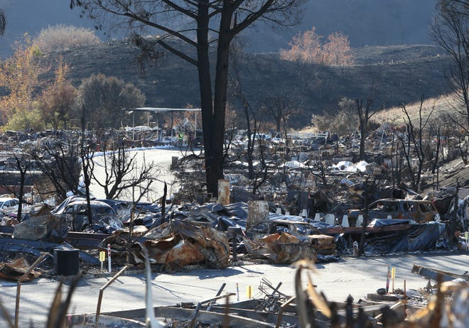 The remains of destroyed homes from the Woolsey Fire are shown at the Seminole Springs Mobile Home Park in Agoura Hills.
