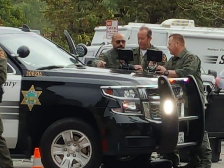 Drone operators with the Ventura County Sheriff's Office work outside a home on Teasdale Street in Thousand Oaks where a man has apparently barricaded himself Wednesday morning.